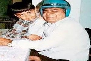 Virat Kohli with his father